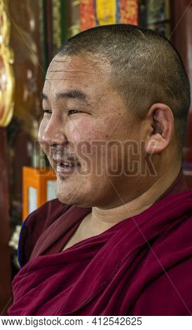 Mörön, Mongolia - August 17, 2019: Buddhist Monk Wit Red Habit Clothes In Buddhist Temple In Mörön,