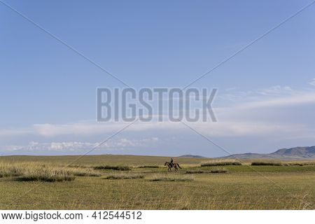 Tsagaan Nuur, Mongolia - August 29, 2019: Man On Horseback In The Steppe Of Mongolia Near Tsagaan Nu