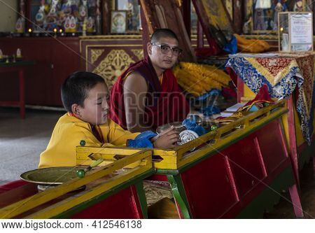 Bulgan, Mongolia - August 18, 2019: Yong Monk In Buddhist Monastery Of Dashchoinkhorlon Khiid With O