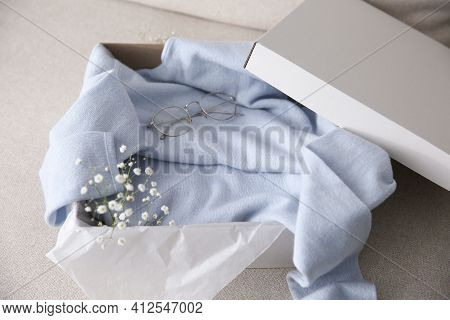 Soft Cashmere Sweater In Box On Sofa