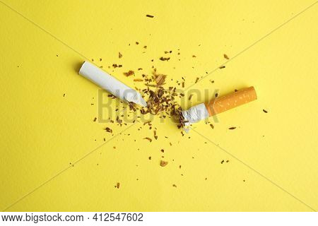 Broken Cigarette On Yellow Background, Flat Lay. Quitting Smoking Concept