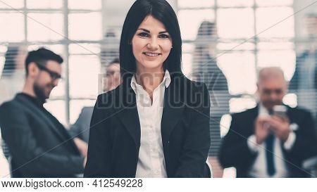 Confident Young Business Woman Sitting In A Modern Office