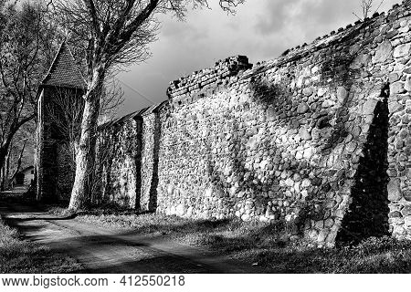 Medieval Defensive Walls With A Tower In The City Of Osno In Poland, Monochrome