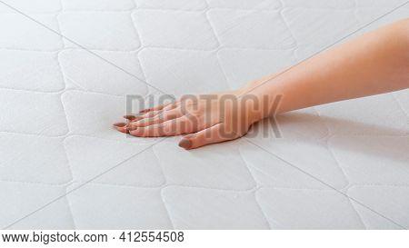 Woman Choosing New Mattress. Female Hand Pressing Testing Mattress To Check Softness. Choice Comfort