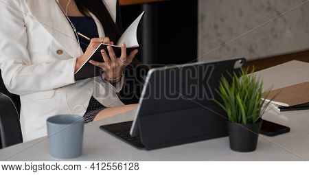 Woman With Video Conference Note Some Data On Notepad For Protection Covid-19.woman Using Tablet Web
