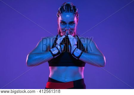 Happy Athletic Girl Mma Fighter Posing Isolated On Blue-pink Background