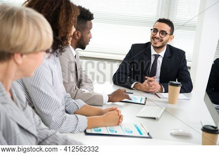 Businessman explains to colleagues a new project in the modern office