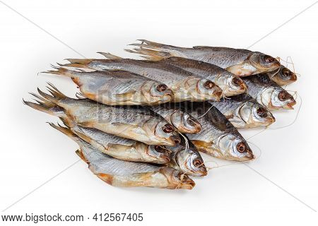 Heap Of Salted And Air-dried Roach Fish On String On A White Background