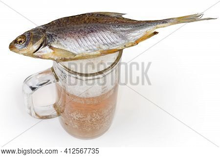 Salted And Air-dried Roach Fish Lies On A Beer Glass With Lager Beer On A White Background, Top View