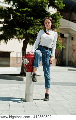 Portrait Of Caucasian Yong Girl Near Fire Hydrant.