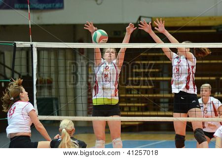 KAPOSVAR, HUNGARY - JANUARY 13: Timea Kondor (with ball) in action at the Hungarian I. League volleyball game Kaposvar (white) vs Budapest SE (white), January 13, 2013 in Kaposvar, Hungary.
