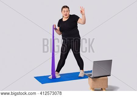 Home Exercises Online For Weight Loss. Plus Size Woman Doing Exercises With An Elastic Band For Fitn