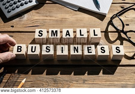 Small Business word on wooden blocks SME and entrepreneur startup businesses concept