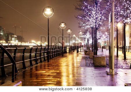 Golden Illuminated Alley On A Rainy Night In The City