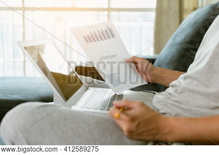 Businessman Checking Report Chart During Quarantine In Living Room. Businessman Analyzing Financial