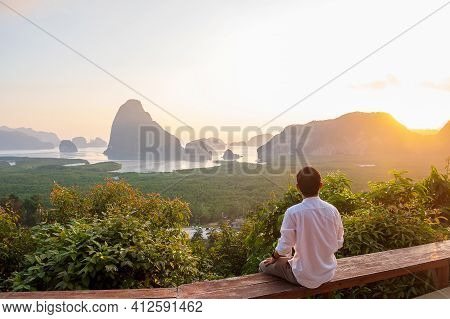 Happy Traveler Man Enjoy Phang Nga Bay View Point, Alone Tourist Sitting And Relaxing At Samet Nang