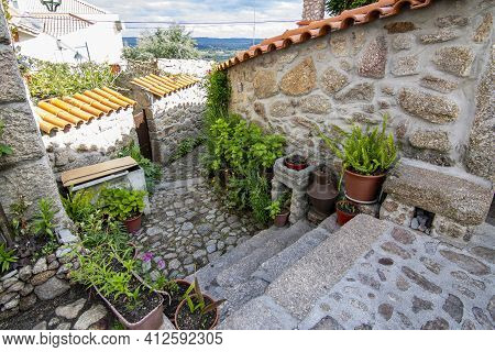 Belmonte, Portugal; May 2017 : Traditional House Full Of Plants And Flowers In Belmonte, Portugal