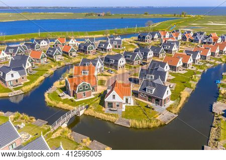 Aerial Scene Of Resort Poort Van Amsterdam Is Characterized By Its Unique Location. With Traditional