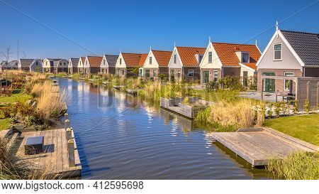 River Scene In Resort Poort Van Amsterdam Is Characterized By Its Unique Location. With Traditional