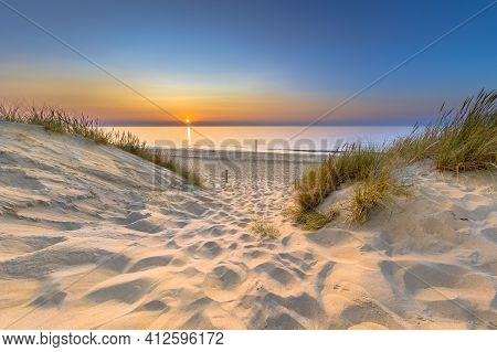 Inviting Sunset View Over Ocean From Dune Over North Sea And Canal In Ouddorp, Zeeland Province, The