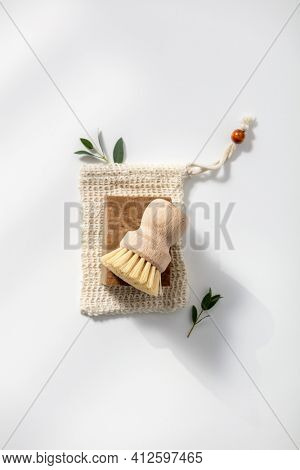 Eco friendly natural cleaning tools and products, Solid soap and natural dish brush on white background. Zero waste concept. Plastic free. Flat lay, top view