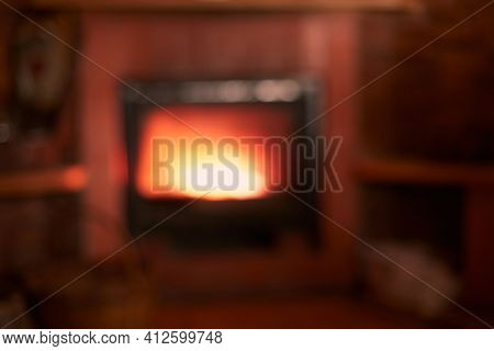 Out Of Focus Fireplace Background Warmth. High Quality Photo