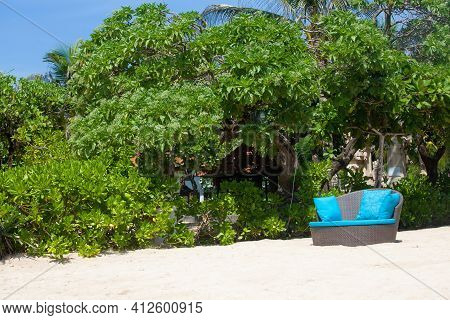 Empty Beautiful Idyllic Beach View Background With Recliners, Chairs, Exotic Straw Tents, Palm Trees