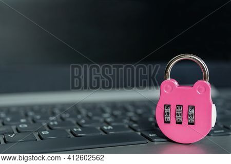 Pink Combination Lock On A Laptop Security