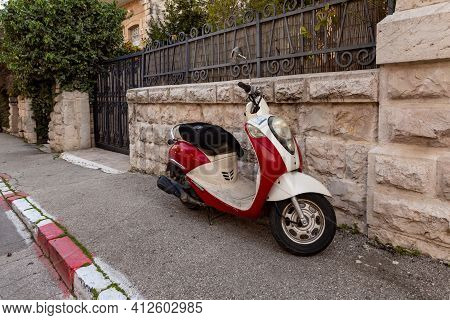 Jerusalem, Israel, February 27, 2021 : Evening View Of An Old Small Scooter Standing On David Marcus