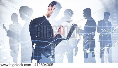 Businessman Holding Clipboard And Taking Notes About Stock Market Rate Behavior. Financial Services