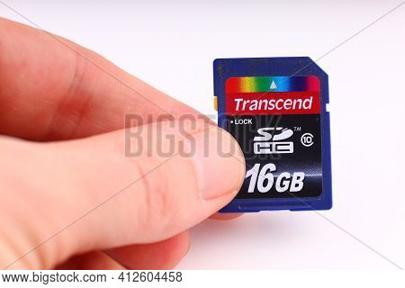 Lviv, Ukraine - March 20, 2020: Memory Card Sd In The Hands