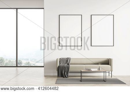 Light Modern Living Room Interior With Panoramic Windows Furnished By Beige Sofa, Coffee Table And T