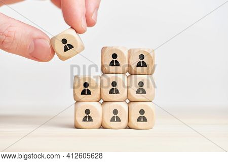 Teambuilding And Teamwork Concept On Wooden Cubes With Abstract Personas Employee.