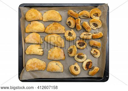 Frozen Baked Patties And Dumplings In Dough On A Baking Sheet On Baking Paper, Isolated On A White B