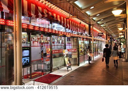 Kyoto, Japan - April 16, 2012: People Visit Pachinko Arcade In Kyoto, Japan. Annual Proceeds From Pa