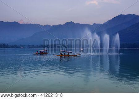 Reflection Of Himalayan Mountains On Dal Lake, Srinagar, Jammu And Kashmir, India. Houseboats Floati