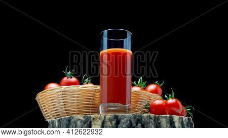 Tomato Juice In A Glass On A Wooden Board With Tomatoes On A Black Background.