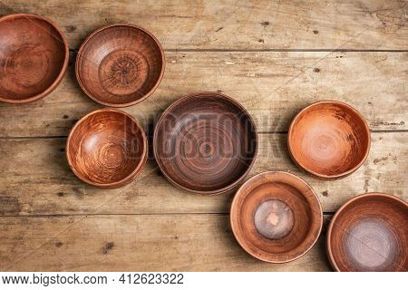 Handmade Empty Ceramic Dishes And Plates On Wooden Background