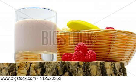 Fruit Yogurt Isolated On White Background Fruit In A Basket, Raspberry Yogurt In A Glass, Close-up.