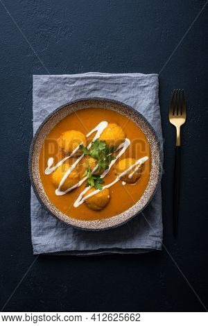 Malai Kofta Curry On A Black Background, Indian Cuisine, View From Above