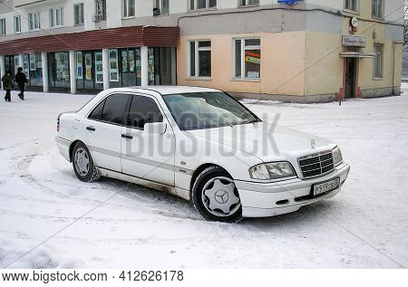Ufa, Russia - January 3, 2006: White Saloon Car Mercedes-benz C-class (w202) In The City Street.