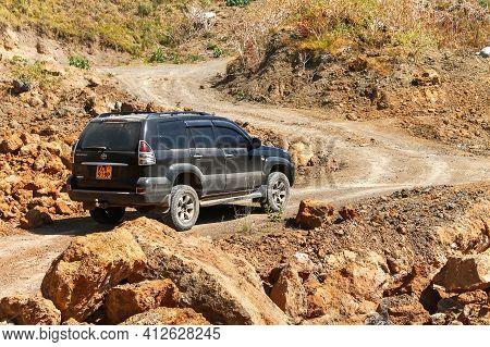 Lake Nakuru National Park, Kenya - February 1, 2021: Black 4x4 Car Toyota Land Cruiser Prado 120 At