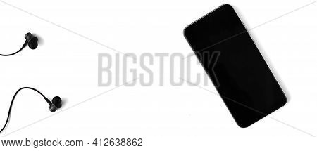 Headphones And Smartphone On White Isolated Background. Space For Text. Copy Space. Flat Lay. Banner