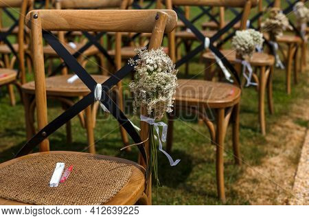 Rows Of Wooden Chairs For Guests Standing On The Grass In Garden Of France Chateau. Wedding Ceremony
