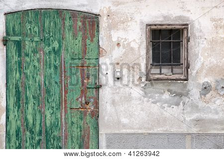 Old wooden door with green paint peeling - Emilia Romagna, Italy