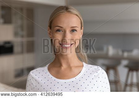 Headshot Portrait Of Smiling Woman Pose At Home