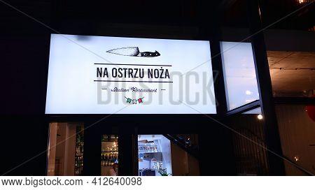 Warsaw, Poland. 15 March 2021. Sign Na Ostrzu Noza Italian Restaurant. Company Signboard Na Ostrzu N
