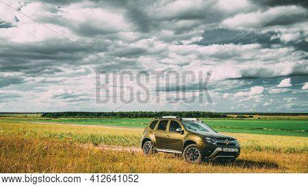 Gomel, Belarus - June 13, 2018: Renault Duster Suv In Summer Meadow Landscape. Duster Produced Joint