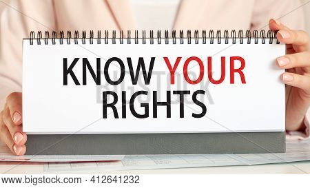 Businessman Showing Text Know Your Rights On A Cardboard