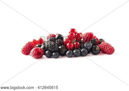 Ripe Berries And Fruits Isolated On White Background. Juicy And Delicious Raspberries, Currants, Mul